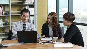 Asian corporate executives meeting in office