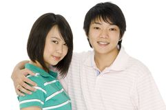 Asian Couple. Two young asian adults hugging on white background royalty free stock photo