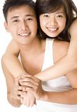Asian Couple 5. A good-looking man and woman in white holding hands Royalty Free Stock Photos