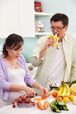 Asian couple activity in kitchen Royalty Free Stock Images