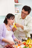 Asian couple activity in kitchen Royalty Free Stock Photos