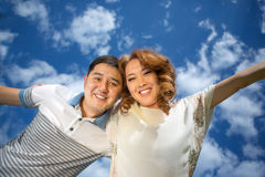 Asian couple against the sky Stock Images
