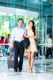 Asian couple arriving in hotel. Lobby stock image