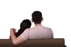 Asian couple from back on couch Stock Photos