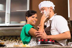 Asian couple baking chocolate cake in kitchen Royalty Free Stock Photos