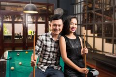 Asian couple in the bar Royalty Free Stock Images