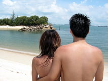Asian couple at beach Stock Image