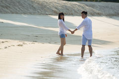 Asian couple on the beach. Royalty Free Stock Photo