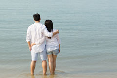 Asian couple on the beach. Royalty Free Stock Images