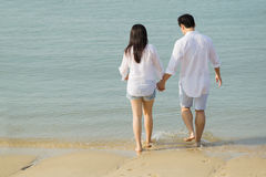 Asian couple on the beach. Stock Images