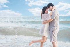 Asian couple on beach Stock Photos