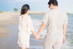 Asian couple on beach Stock Photo