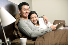 Asian couple in bed Stock Image