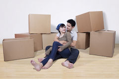 Asian couple with boxes at home Royalty Free Stock Photography