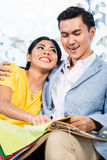 Asian couple buying sofa in furniture store Stock Photo