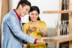 Asian couple buying stuff in furniture store Stock Photography