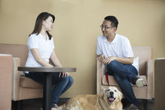 Asian couple at cafe. With their pets Stock Photo
