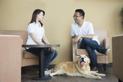 Asian couple at cafe. With their pets Royalty Free Stock Photography