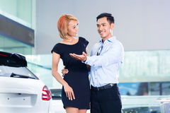 Asian couple choosing luxury SUV car stock images