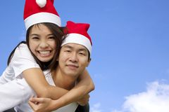 Asian couple in Christmas hats Stock Photography