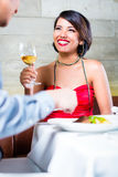 Asian couple clinking wine glasses in bar Royalty Free Stock Image