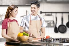 Free Asian Couple Cooking Food With Kitchenware Stock Photography - 183261162