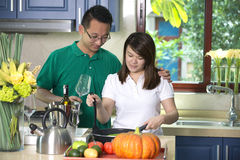 Asian couple cooking Royalty Free Stock Photography