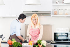 Asian couple cooking in stylish and modern kitchen Stock Photos