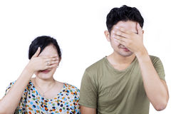 Asian couple cover face - isolated Stock Photos