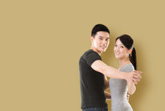 Asian couple dancing Royalty Free Stock Photos