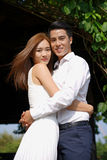 Asian couple dating and holding each other outdoor Stock Photos