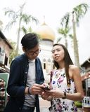 Asian couple dating outdoor together Stock Photos
