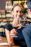 Asian couple drinking red wine Royalty Free Stock Photography