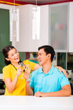 Asian couple drinking white wine at home Royalty Free Stock Photo