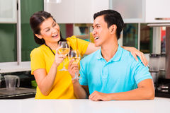 Asian couple drinking white wine at home Stock Photo