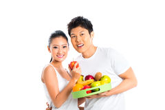 Asian couple eating and living healthy Royalty Free Stock Image