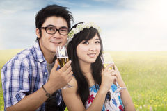 Asian couple enjoy champagne at field Stock Photos