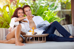 Asian couple enjoy in resort. Asian couple enjoy in summer vacation, girl pointing and showing her boyfriend resort Stock Image
