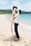 Asian couple enjoy time at beach. Asian couple is having fun at beach Royalty Free Stock Image