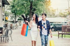 Asian Couple Enjoying Romance Spending shopping bags Fashion in. Shopping street stock images