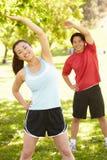 Asian couple exercising Royalty Free Stock Photos