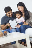 Asian Couple Family Child Using Tablet Computer Royalty Free Stock Images