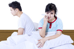 Asian couple fight on bed - isolated Stock Photography