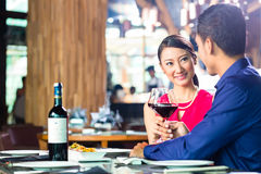 Asian couple fine dining in restaurant Stock Image