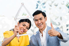 Asian couple with folding rule Stock Photos