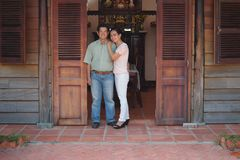 Asian couple in front of their house Royalty Free Stock Photos