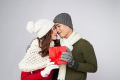 Asian couple giving each other christmas gifts Royalty Free Stock Image