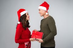Asian couple giving each other christmas gifts Stock Photo