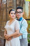Asian couple groom and bride. With outdoor prewedding portrait Stock Images