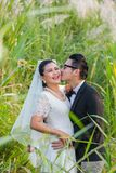 Asian couple groom and bride. With outdoor prewedding portrait in nature background Royalty Free Stock Images